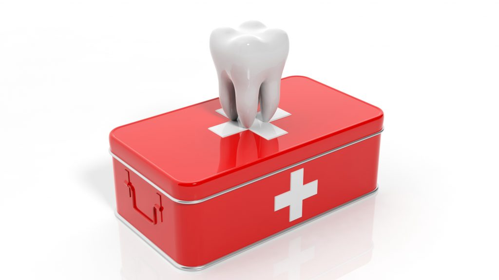 illustration of a tooth on top of a red first aid kit